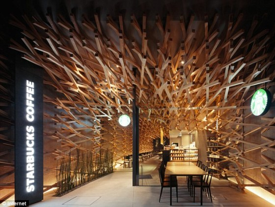 Designed to look like a cluster of wooden coffee stirrers this Starbucks Coffee House has upped the architectural game.